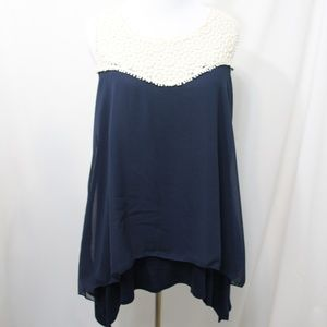 Le Rouge navy blue sleeveless top.